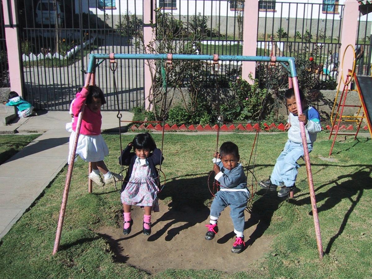kids on swingset