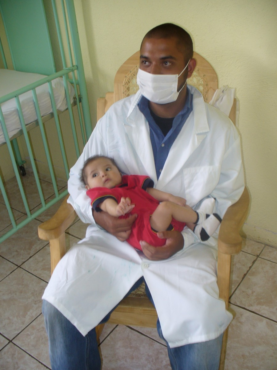 malawi doctor and baby resting