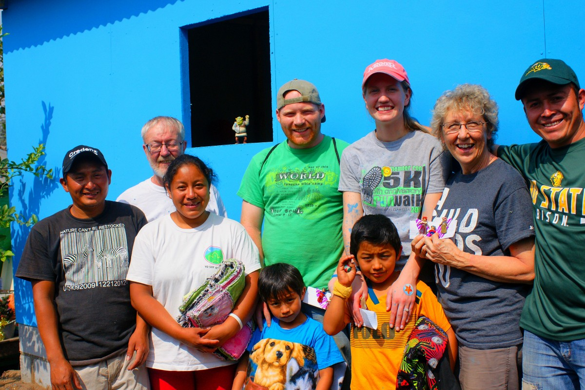 volunteers with family